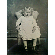 Tintype portrait cute chubby faced pouting little girl posed in petite chair