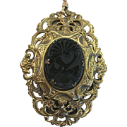 Late Victorian Brass Filigree Pin/Pendant with carved Jet on watch fob