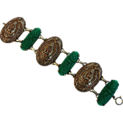 Vintage carved green celluloid flower bracelet with Oriental motif - Confucius and cranes.