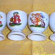 Child's... Vintage... Egg Cup Fairy Tale  With Decals...Set Of Four...Assorted Designs