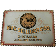 Late 19th Century  Nutwood Whiskey Reverse on Glass Advertising Sign...