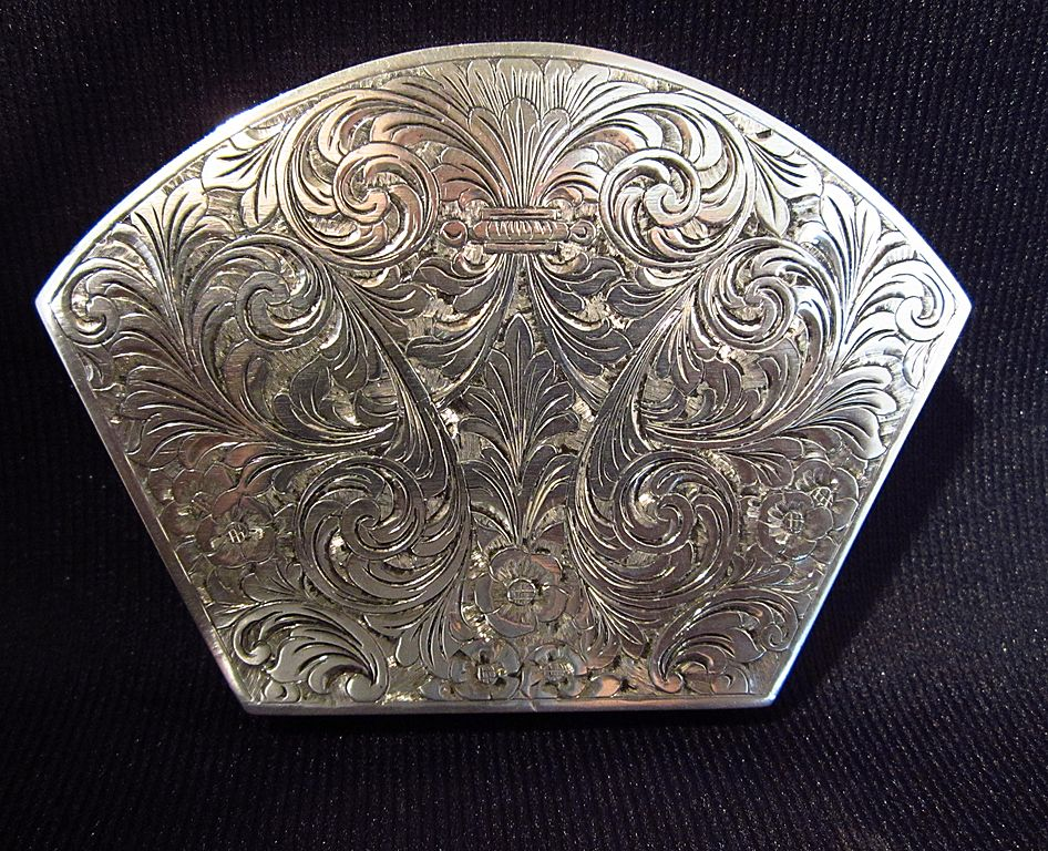Silver Compact.....