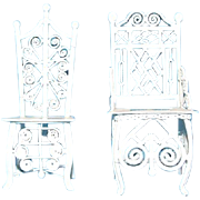 Pair of ornate white vintage metal doll chairs