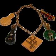 Neat Vintage BAKELITE Musical Instrument Charm Bracelet