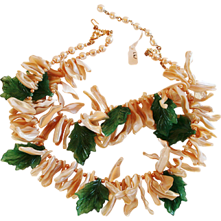 20 Inches Double Strand Coral and Plastic Leaves Pearls That look  Real Signed Stanley Hagler and Ian St. Gielar