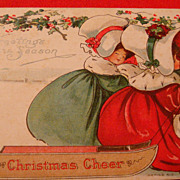 "B.E.B. ""Christmas Cheer"" Early Postcard Two Ladies in Huge Bonnets, Velvet Dresses and Muffs Pulling Wooden Sled"