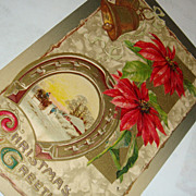 John Winsch 1910 Christmas Postcard Gold Gilded Horseshoe, Bells, Poinsettias, Snow Covered Village