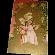 Embossed Victorian Era Christmas Postcard Little Bonnet Girl With Her Doll Gold Gilt