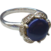 Size 7 1/4 Sterling Silver Ring With Deep Blue Cabochon Stone Flower Setting