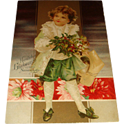 1906 German Kopal Christmas Postcard Child in Lace Coat, Knickers, Curls, Holly Leaves and Berries