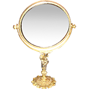 Shiny Brass or Gold Plated Ormolu Beveled Vanity Mirror on Figural Stand