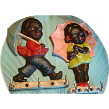 Pair Black Americana Umbrella Girl and Boy Key or Hot Pad Holder Cast Iron Children 1960s