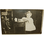 Early Real Photo Postcard Little Girl Having Tea Party With Teddy