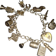 Sterling Silver Charm Bracelet With 15 Charms Mostly Sterling, One Mechanical