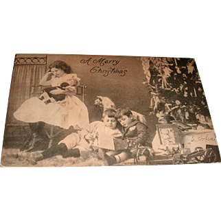 Real Photo Christmas Postcard 1907 Tinted Little Girl, Fashion Doll, Doll's Teddy, Boys Reading, Rocking Horse, Tree