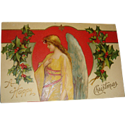 1911 German Embossed Christmas Postcard Beautiful Angel in Yellow, Holly Leaves and Berries