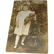 Real Photo Postcard Young Girl, Dog in Stroller, German or French China Doll