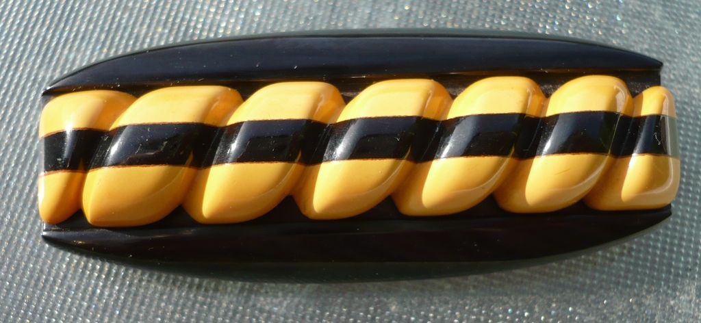 Bakelite Black & Cream Carved Pin