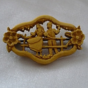 Tiny Carved Bakelite Romantic Pin