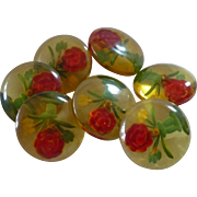 Six Floral Reverse Carved Bakelite Buttons