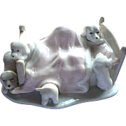 Porcelain Dogs in Bed Figurine