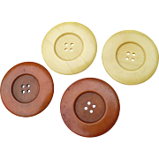 Four Large Celluloid Buttons