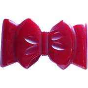 Small Red Bakelite Bow Pin