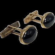 Gold Cabochon Garnet Cuff links, 20th century