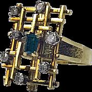 Abstract 18K, Emerald and Diamond Ring, English C.1970.