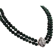 Vintage double strand of Emerald beads with 18K Diamond clasp.