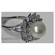 18K Cultured Pearl and Diamond cluster Ring.