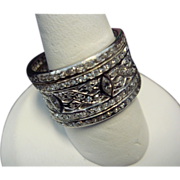 Wide Platinum Eternity Band Adorned with Diamonds