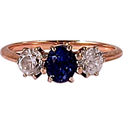 SAPPHIRE RING - 14K Rose Gold Sapphire with (1) Zircon on each side.