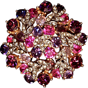 SPHINX BROOCH - Pink & Purple & Clear Rhinestones with Silver Leafs attached to a Gold-tone metal. Signed