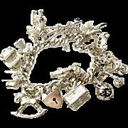 Vintage 1971 STERLING Silver Bracelet 14 CHARMS Some Rare