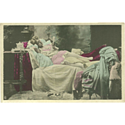 Vintage Tinted Risque Postcard of Lady Reading in Bed