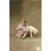 Hand Tinted German Photo Postcard of Baby and Puppy