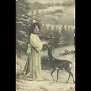 German Christmas Tinted Photo Postcard of Girl and Deer