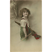 Tinted 1912 Photo Postcard of Young Girl with Rake