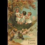 PFB Embossed Easter Postcard of Three Children in Bird's Nest
