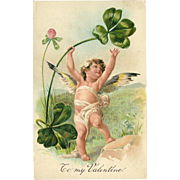 Embossed PFB Valentine Postcard of Cherub with Shamrock