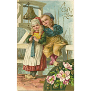 Embossed German Postcard with Dutch Boy and Girl