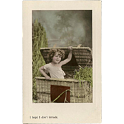 Aristophot Real Photo Postcard of Child in Basket