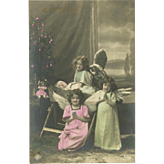 Tinted French Real Photo Christmas Postcard of Children Dressed as Angels