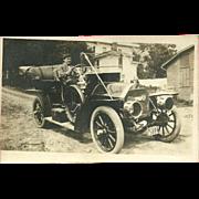 Real Photo Postcard of Man Driving Old Car