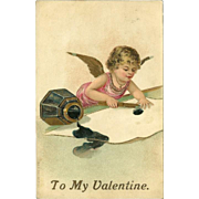Embossed 1907 Valentine Postcard with Cherub and Overturned Ink Bottle