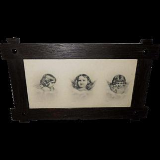 Three Cherubs Copyright 1904 in Dark Wood Frame