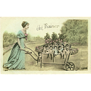 Glossy French Photo Postcard of Lady Pushing Group of Babies