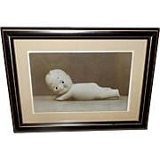 Small Framed Kewpie Doll Embellished with Flirty Googly Eyes