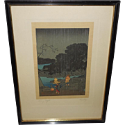 Japanese Woodblock Print of Rainy Night by Hiroshige.